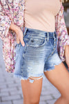KAN CAN Emmie Denim Shorts - Medium Wash closet candy women's trendy exposed button ripped jean shorts close up side