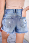 KAN CAN Emmie Denim Shorts - Medium Wash closet candy women's trendy exposed button ripped jean shorts close up back