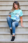 """Be Kind"" Tie Dye Graphic Tee - Blue & Green women's short sleeve tee with round neckline closet candy sitting"
