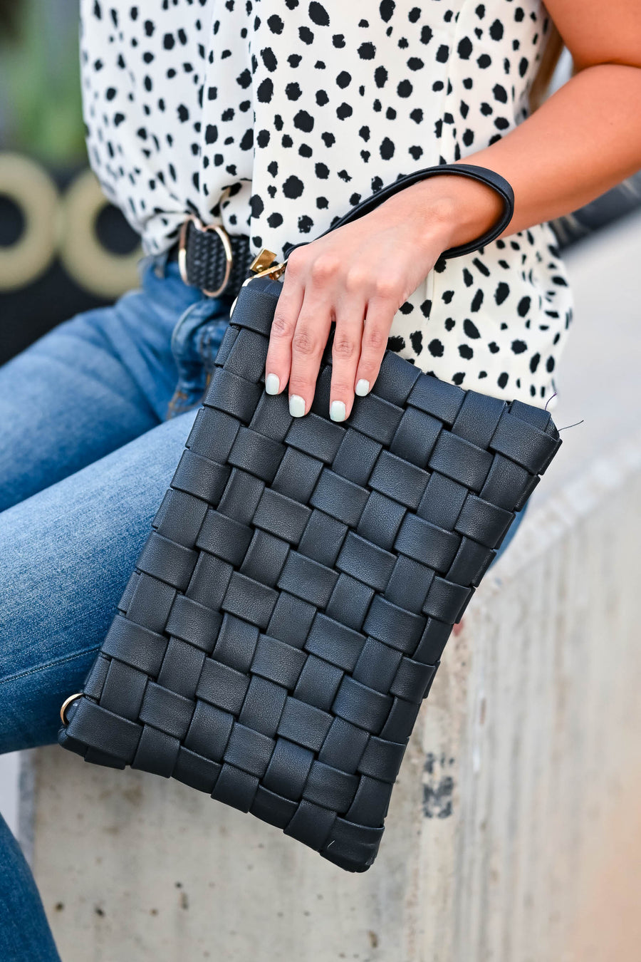 Play For Keeps Clutch - Black women's vegan leather clutch featuring woven design and zipper closure. Interior lining features two open pockets and one zipper pocket. Adjustable, removable strap included closet candy front