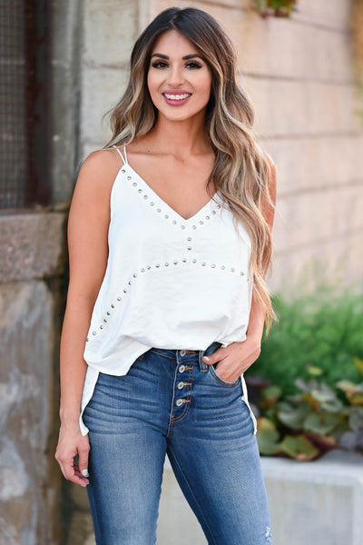 That's Just It Tank Top - Ivory omen's woven silken top featuring v-neckline, side split hem, studded detailing, and dual spaghetti straps with criss-cross design at back closet candy front