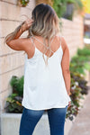 That's Just It Tank Top - Ivory omen's woven silken top featuring v-neckline, side split hem, studded detailing, and dual spaghetti straps with criss-cross design at back closet candy back