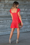 LUSH She's A Firecracker Mini Dress - Red women's woven mini dress featuring square neckline with ruffle overlay, short ruffle sleeves, lace trim, decorative button details at front, and ruffled hem closet candy back