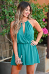 LUSH Still Be Here Romper - Teal Green women's trendy woven romper featuring halter neckline with keyhole cutout detail, plunging front opening, surplice bodice, and elastic waistband. Keyhole cutout with button closure at back closet candy close up