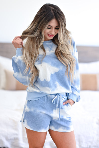 Cloud Chasing - Tie Dye Loungewear - Blue women's ribbed knit loungewear top and shorts. Long sleeve top features round neckline, reverse stitching detail, drop shoulders, and banded cuffs and hem. Matching lounge shorts feature elastic drawstring waistband and side pockets closet candy front