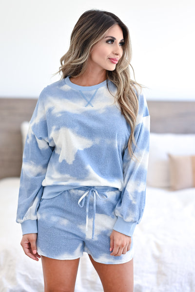 Cloud Chasing - Tie Dye Loungewear - Blue women's ribbed knit loungewear top and shorts. Long sleeve top features round neckline, reverse stitching detail, drop shoulders, and banded cuffs and hem. Matching lounge shorts feature elastic drawstring waistband and side pockets closet candy front 3