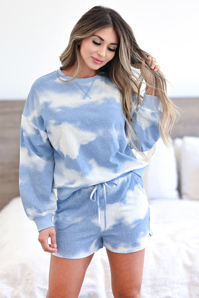 Cloud Chasing - Tie Dye Loungewear - Blue women's ribbed knit loungewear top and shorts. Long sleeve top features round neckline, reverse stitching detail, drop shoulders, and banded cuffs and hem. Matching lounge shorts feature elastic drawstring waistband and side pockets closet candy front 2