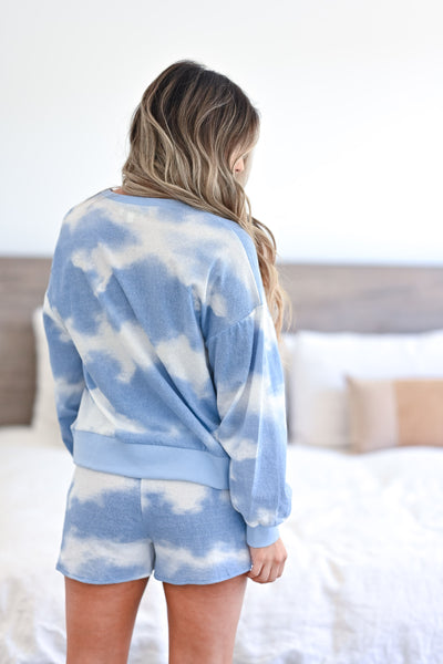 Cloud Chasing - Tie Dye Loungewear - Blue women's ribbed knit loungewear top and shorts. Long sleeve top features round neckline, reverse stitching detail, drop shoulders, and banded cuffs and hem. Matching lounge shorts feature elastic drawstring waistband and side pockets closet candy back