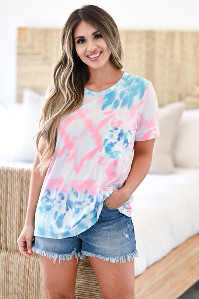 Until Next Time Top- Multi Women's casual multicolor tie-dye top featuring round neckline, cuffed short sleeves, chest pocket, and raw hem design closet candy front 3