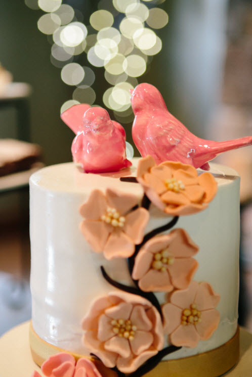 Wedding Story: Tess and Nick's Bigfork, Montana Wedding – Wedding Cake with Lovebird Cake Topper – from Piece of Cake Wedding Decor