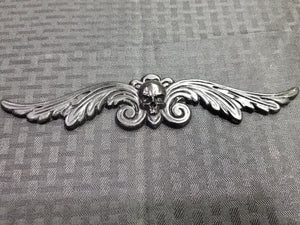 Skull and on Filigree Wings (resin)