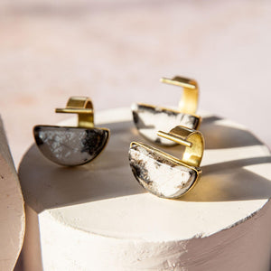 Unique brass rings to wear with your capsule wardrobe.