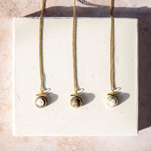 Gorgeous gem-like pottery and brass necklace ethically made by fairtrade artisans.