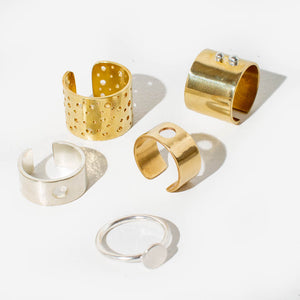 MULXIPLY adjustable statement rings in Brass and Sterling Silver.