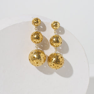 Dramatic chandelier earrings in brass. Handmade by fair trade artisans.