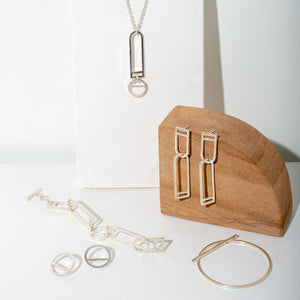 Designed in Portland, Maine and made by fair trade artisans in Nepal. Contemporary jewelry by MULXIPLY.