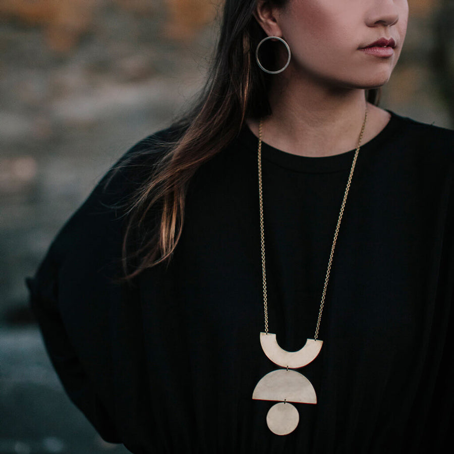 A dramatic statement necklace inspired by mid-century shapes.