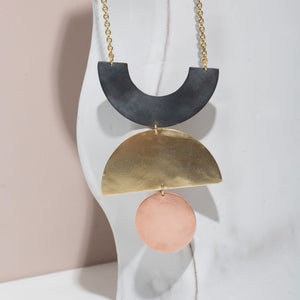 A dramatic statement piece necklace inspired by mid-century shapes made by MULXIPLY