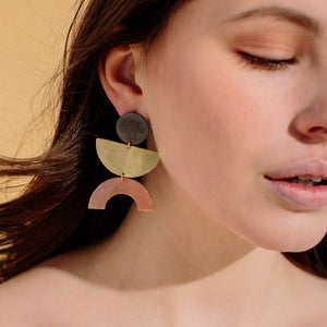 A dramatic statement piece inspired by mid-century shapes, these earrings are both bold and versatile.