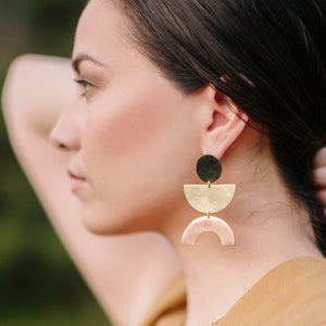 Bold minimalist earrings made with mixed metals are sure to make a statement
