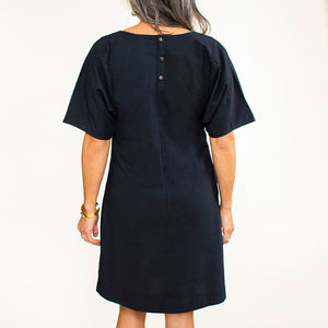 Hand carved coconut buttons add a special touch to this handmade black shift dress.