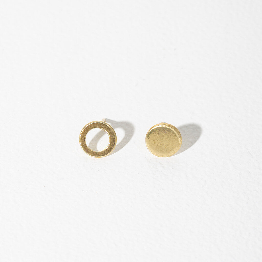Our circle stud earrings are an ode to mismatched minimalism