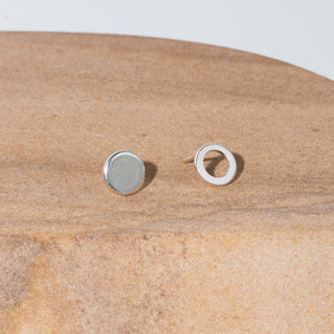 Our circle sterling silver stud earrings are an ode to mismatched minimalism