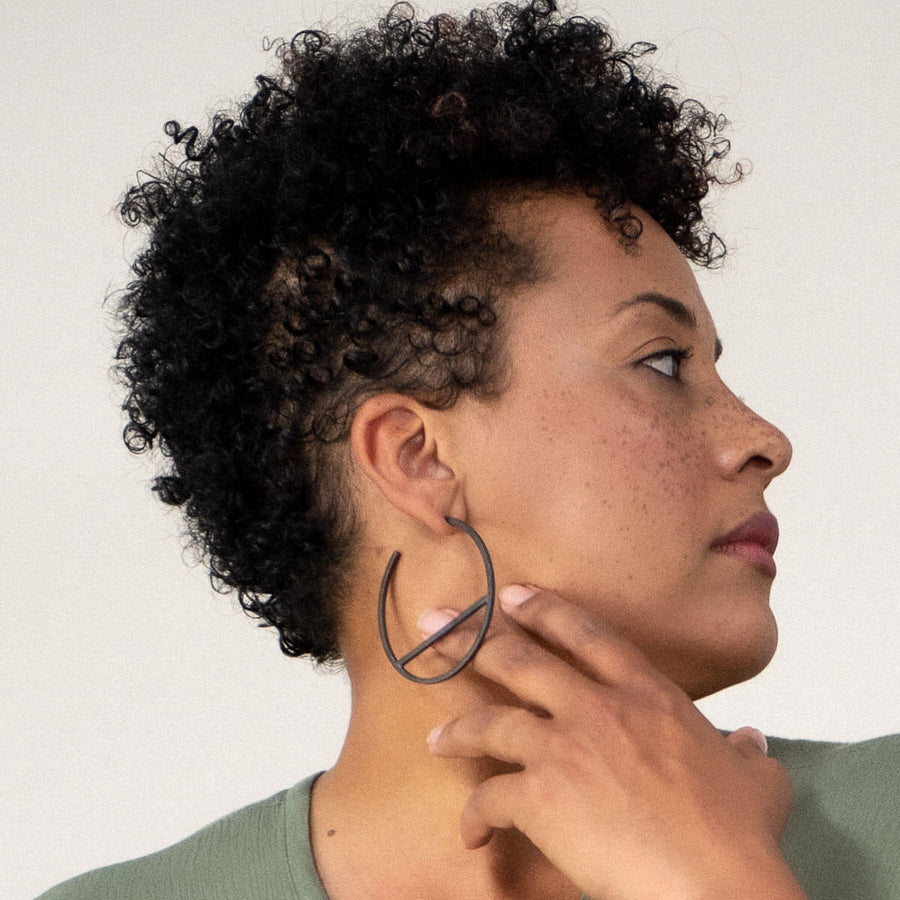 MULXIPLY Embrace Hoop Earrings - Oxidized Brass