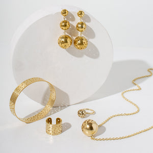 A collection of brass, museum-quality jewelry for your capsule wardrobe by MULXIPLY.