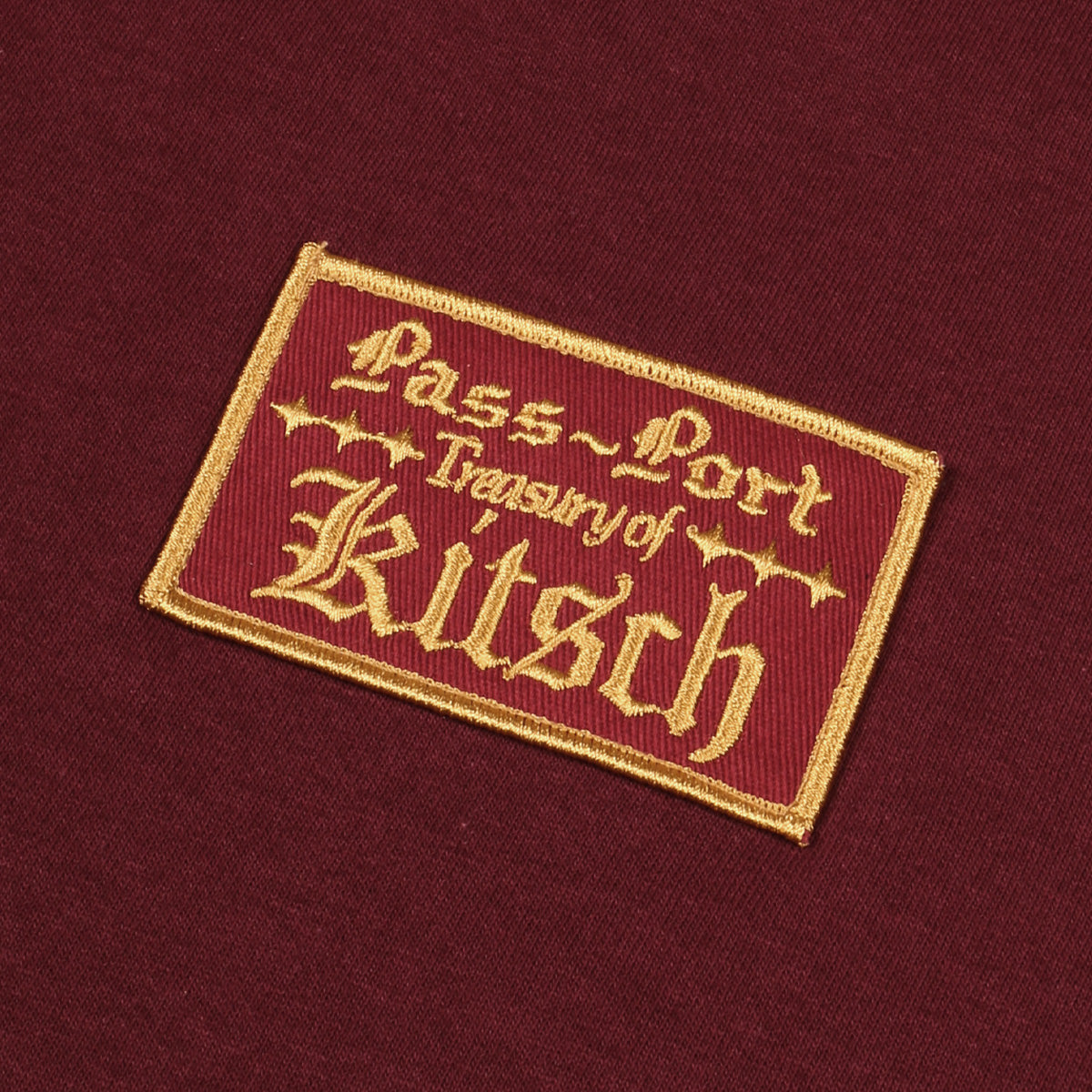"PASS~PORT ""TREASURY OF KITSCH"" TEE BURGUNDY"