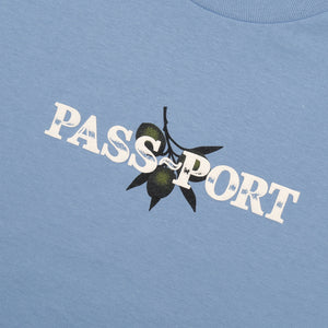 "PASS~PORT ""OLIVE"" PUFF PRINT TEE CAROLINA BLUE"