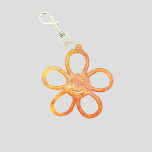 HAPPY FLOWER KEYRING TRANSLUCENT GLITTER ORANGE