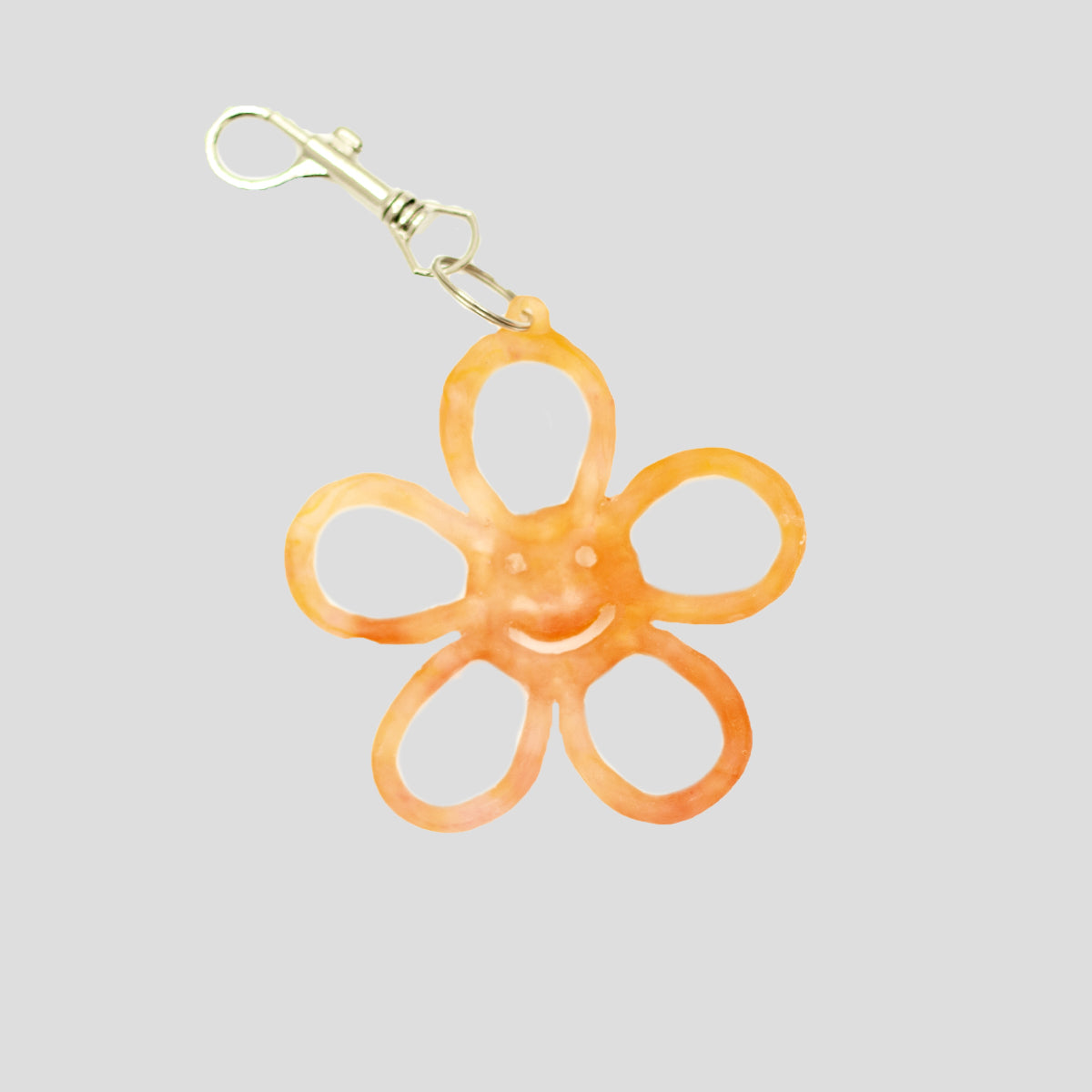 HAPPY FLOWER KEYRING TRANSLUCENT ORANGE