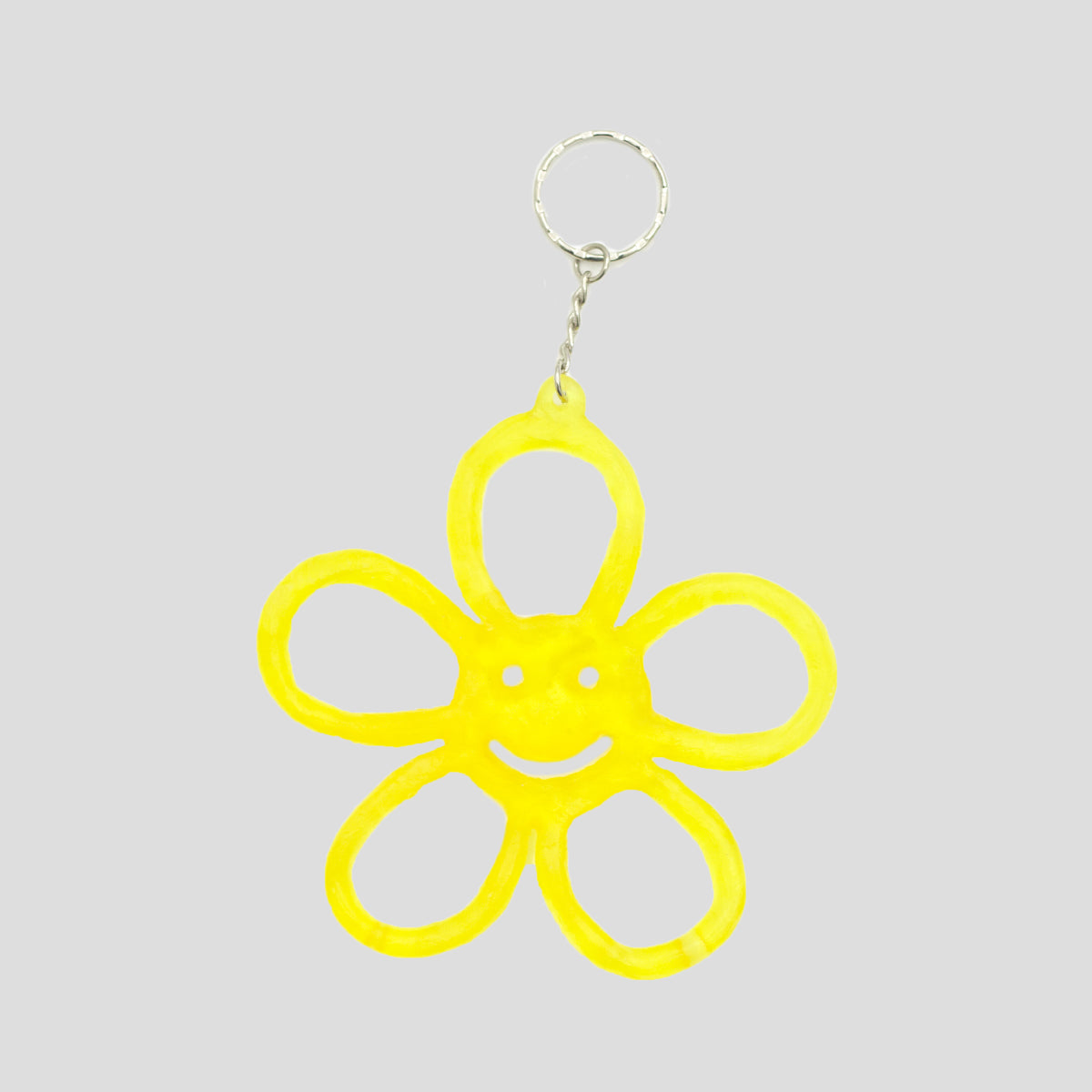 HAPPY FLOWER KEYRING TRANSLUCENT YELLOW