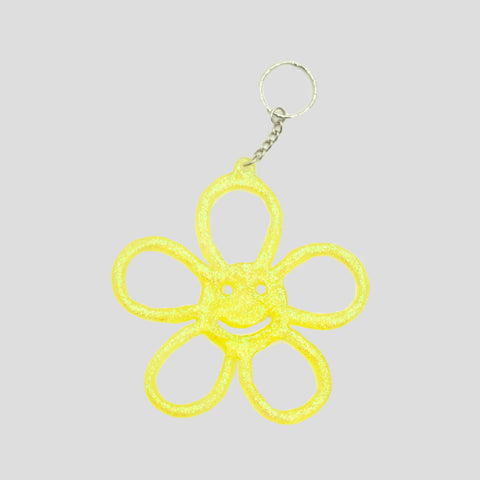 HAPPY FLOWER KEYRING TRANSLUCENT GLITTER YELLOW