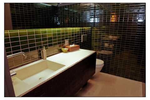 Modern green bathroom with rustic flare