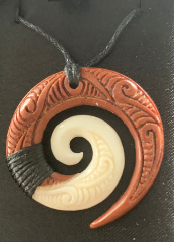 Koru bone & wood pendant