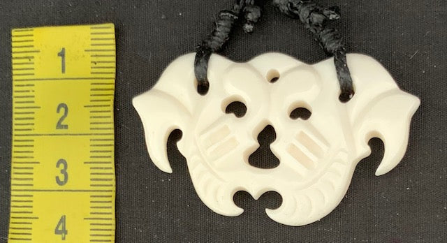 $20 BEEF BONE CARVING PENDANT