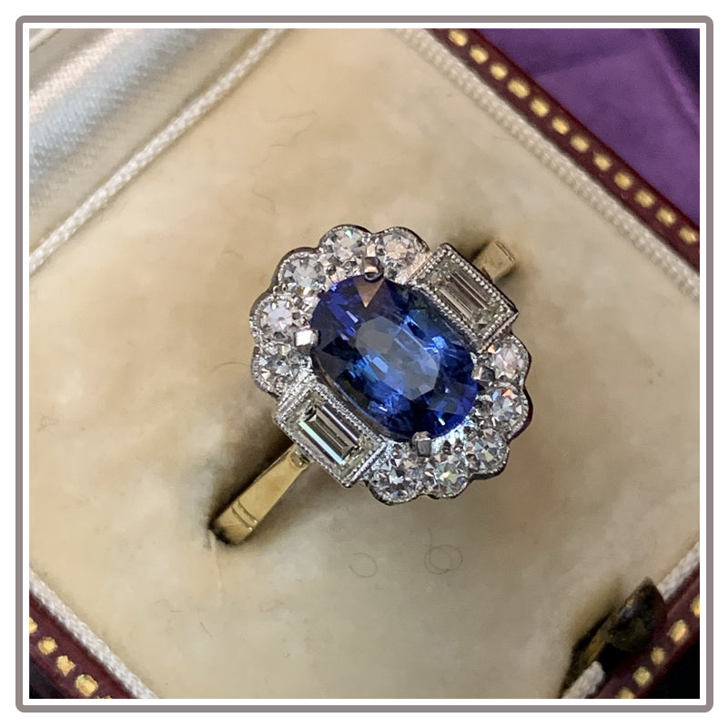 Oval Blue Sapphire and Diamond Halo Engagement Ring