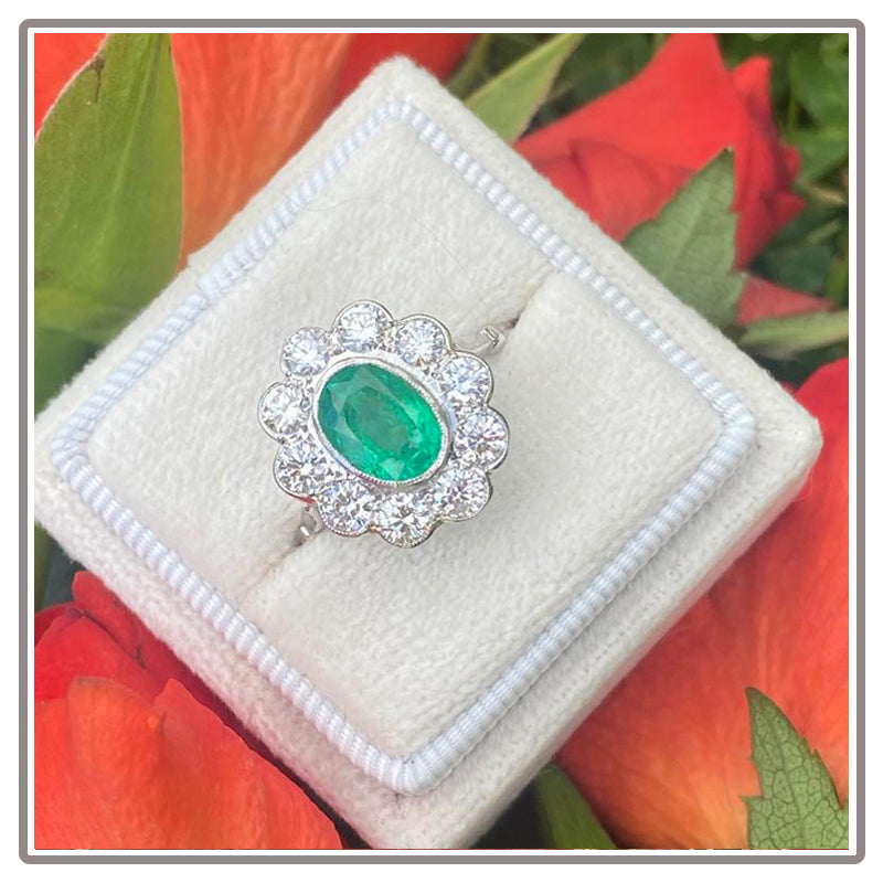 2.26 Carat Oval Emerald and Diamond Halo Engagement Ring