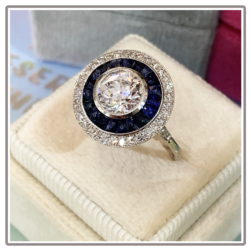 Art Deco Diamond and Blue Sapphire Target Halo Engagement Ring