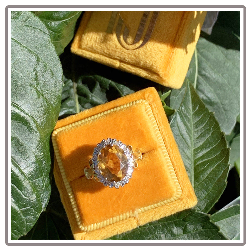 Oval Citrine and Diamond Halo Ring in Yellow Gold