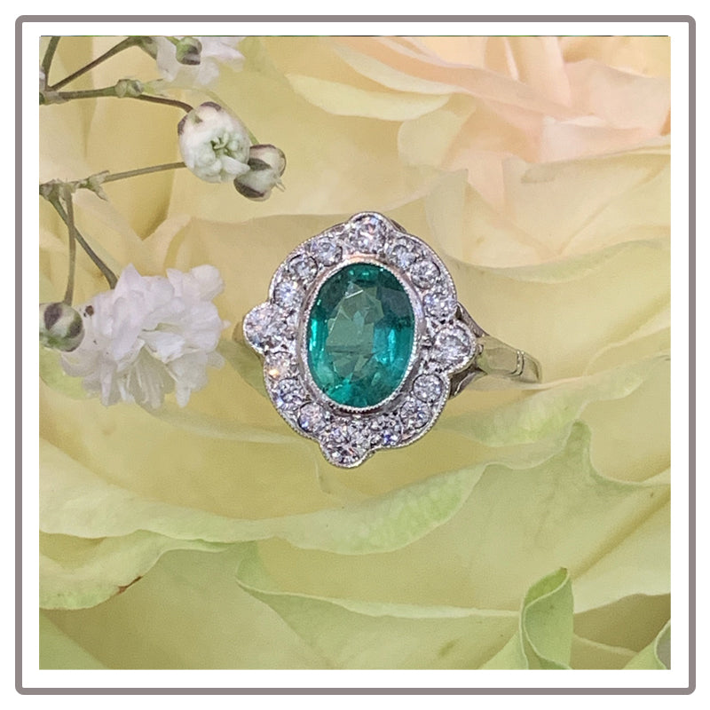 Oval Emerald and Diamond Compass Ring in Platinum