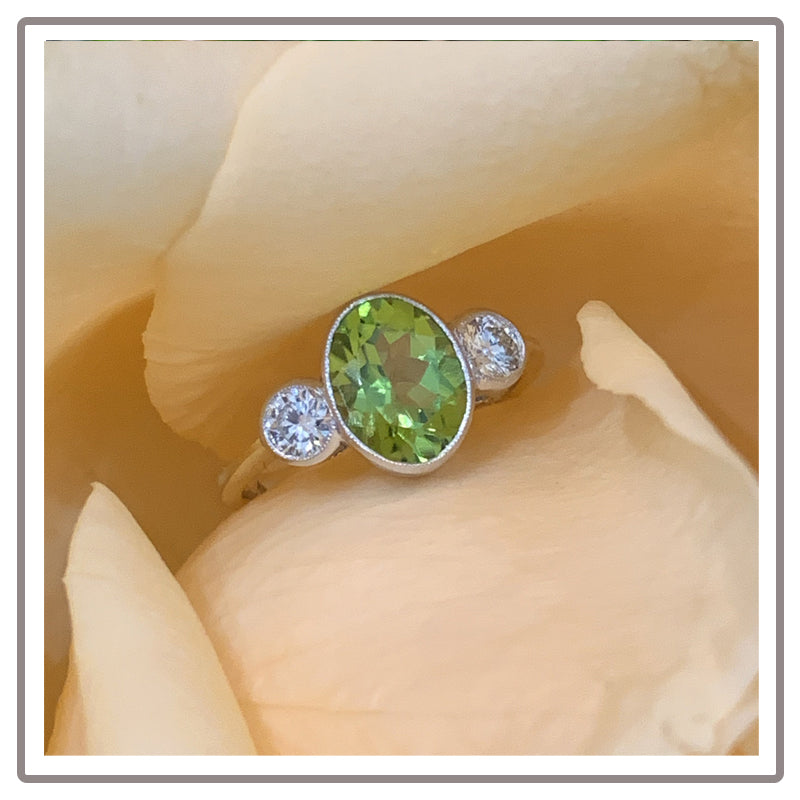 Oval Peridot and Diamond Ring in 18K White Gold