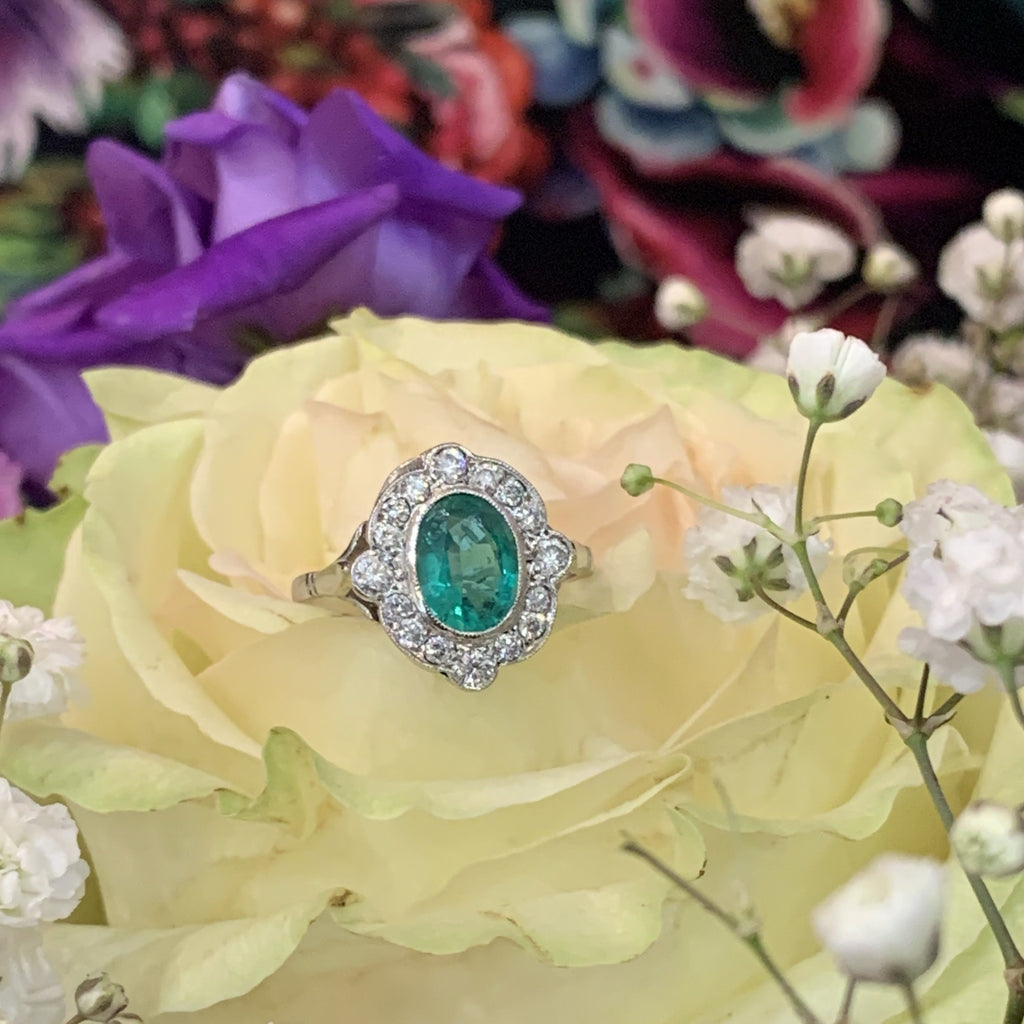 1.10 Carat Emerald and Diamond Compass Halo Ring in Platinum