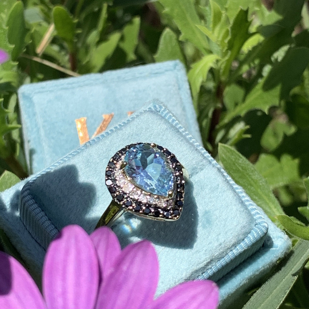 Blue Topaz and White and Black Diamond Halo Ring