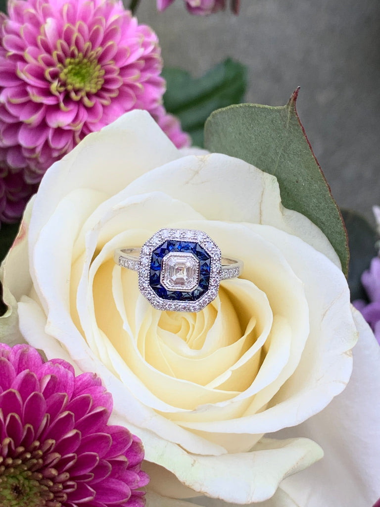 0.80 CTW Asscher Cut Diamond and Sapphire Target Halo Ring in 18ct White Gold