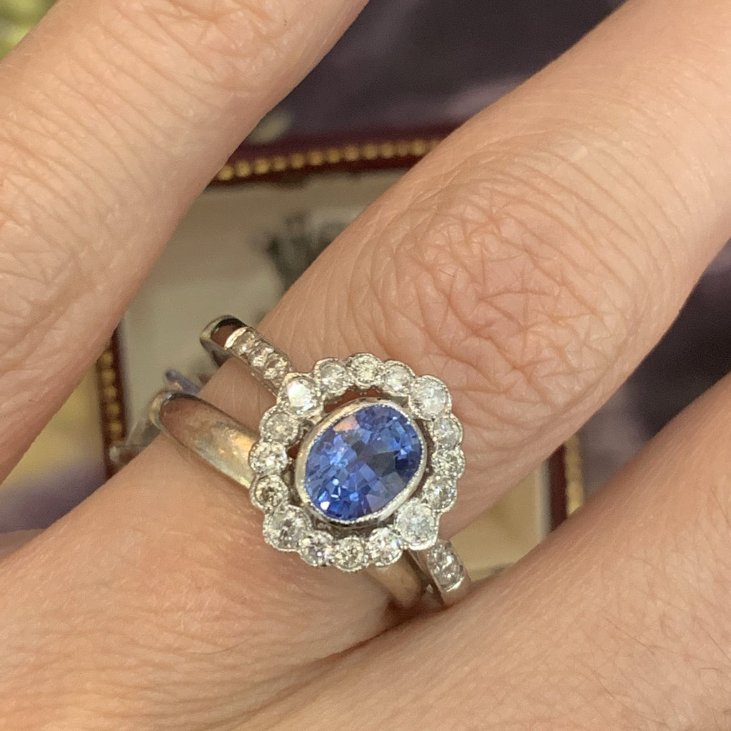 Sapphire and diamond halo ring in platinum