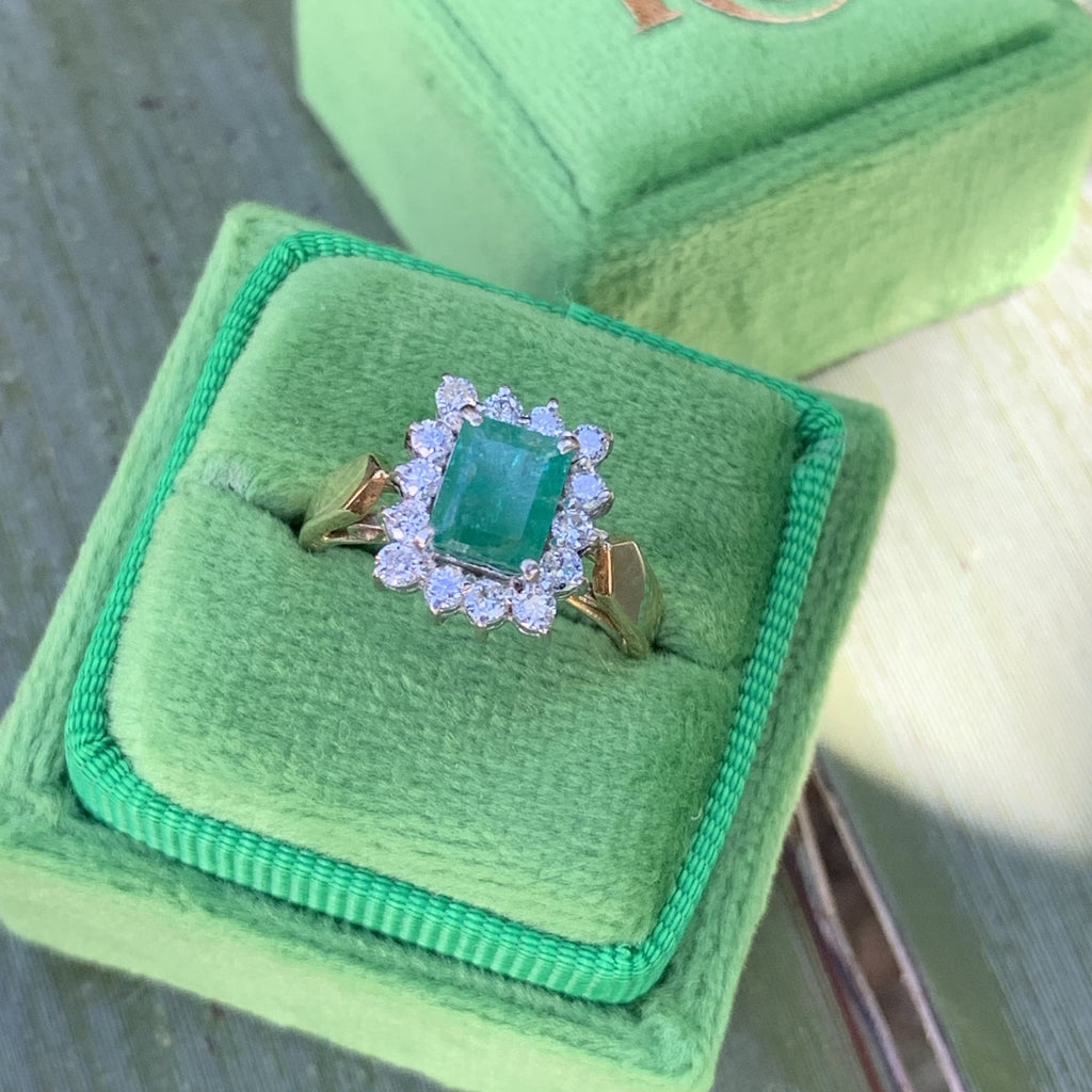 0.79 Carat Emerald and Diamond Halo Ring in 18K Gold