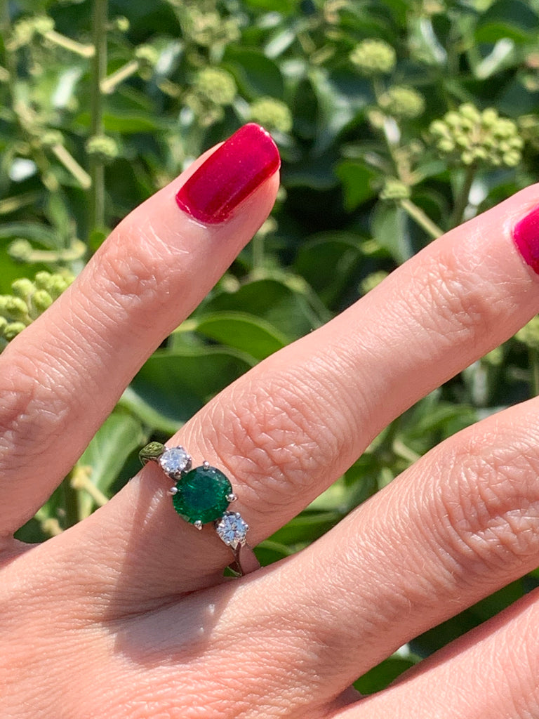 1.00 Carat Emerald and Diamond Ring in 18K White Gold
